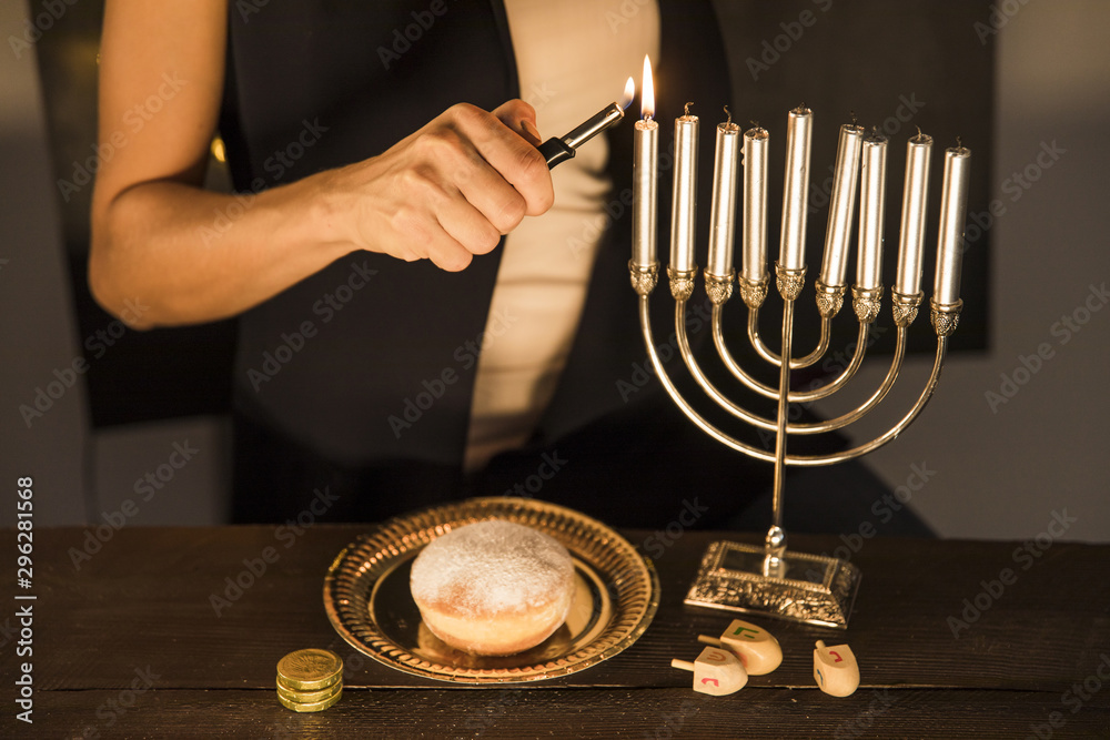 Fototapety, obrazy: Crop woman lighting candles on menorah