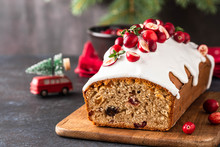 Christmas Cake With Cranberries And Christmas Decorations On A Dark Background.
