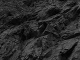 Fototapeta Kamienie -    Black stone background. Mountain close-up. Fragment of the mountain.   Black rock texture.