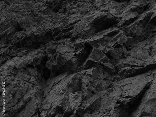 Black stone background. Mountain close-up. Fragment of the mountain.   Black rock texture.  - 296290567