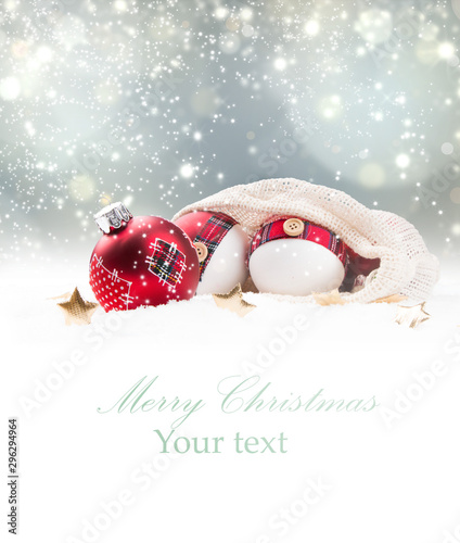 Christmas red ball in snow with blur celebration background. Wallpaper Mural