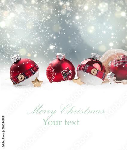 Obraz Christmas red ball in snow with blur celebration background.  - fototapety do salonu