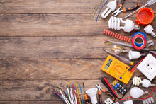 Electrician Equipment On Wooden Background With Copy Space. Top View