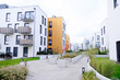 Leinwanddruck Bild - Sidewalk in a cozy courtyard of modern apartment buildings condo with white walls.