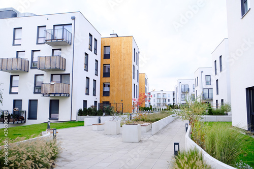 Sidewalk in a cozy courtyard of modern apartment buildings condo with white walls Fototapeta