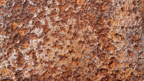 Fototapeta close up background texture of weathered, rusty, and pitted metal