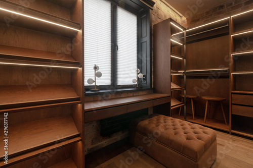 Fotografie, Obraz  Dressing room with empty shelves ottoman chairs with window