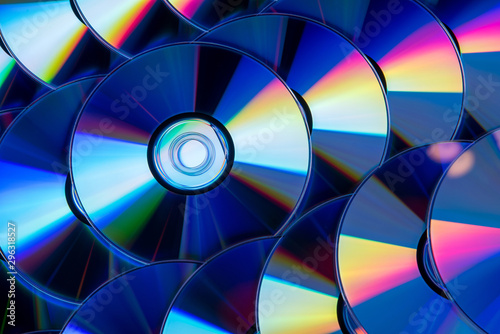 Fototapeta Many musical compact discs with a rainbow spectrum of colors as a bright backgro