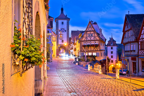 Photo Stands Old building Cobbled street of historic town of Rothenburg ob der Tauber dawn view