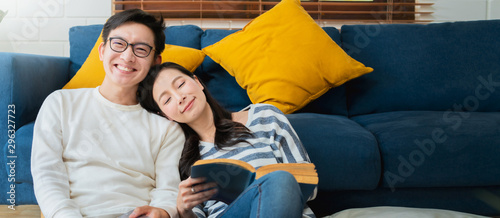 Fototapeta sweet lovey asian family couple sit talk good conversation on sofa in living roo