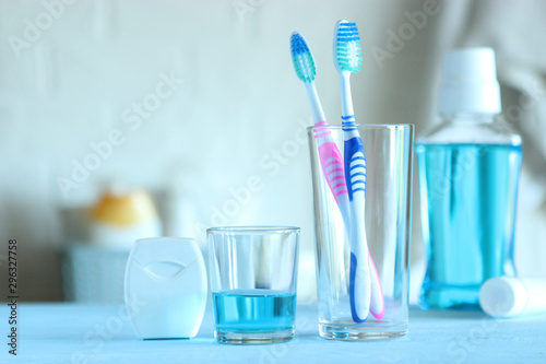 Fotografie, Tablou Toothbrushes and oral cleaners on the table.