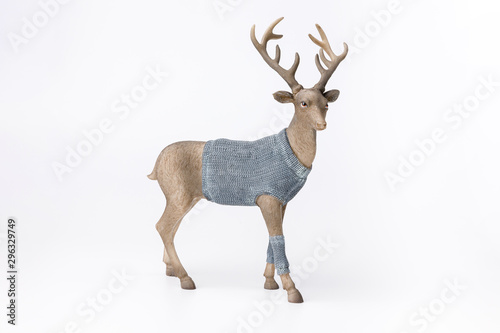 Fotobehang Hert Beautiful Christmas reindeer figurines in blue knitted sweaters and scarf on white background. Male and female.