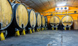 Leinwanddruck Bild - Cider barrels in Asturian Sidreria