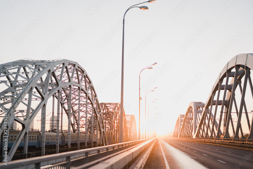 Cityscape with a railway bridge at sunrise