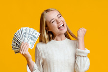 Millennial Girl Holding Dollar Bills And Exclaiming With Success.