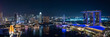 Leinwanddruck Bild - Wide panorama of Singapore skyscrapers at night