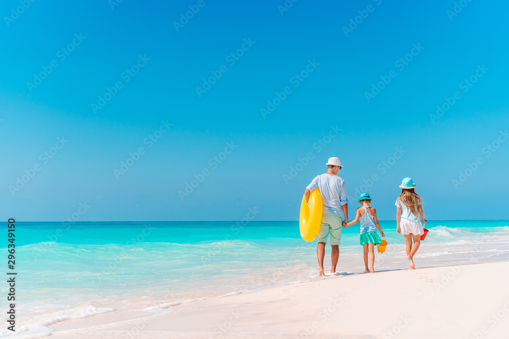Fototapety, obrazy: Happy beautiful family on a tropical beach vacation