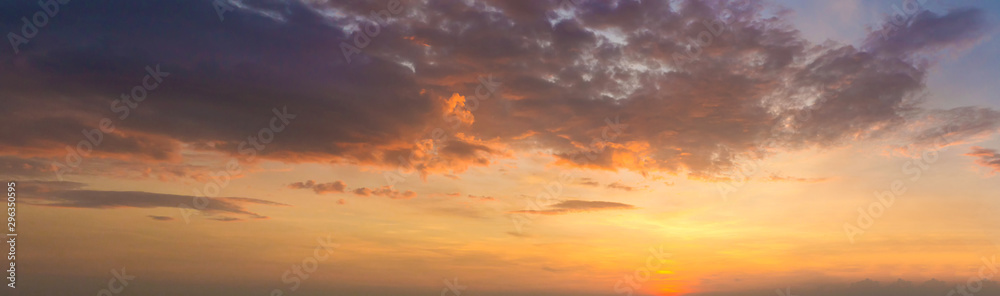 Fototapeta Panorama photo twilight sky background. Colorful Sunset sky and cloud.vivid sky in twilight time background. Fiery orange sunset sky. Beautiful