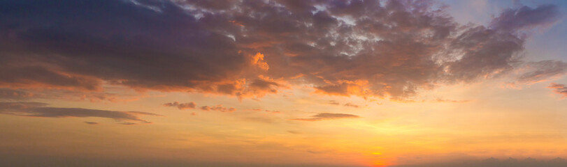 Panorama photo twilight sky background. Colorful Sunset sky and cloud.vivid sky in twilight time background. Fiery orange sunset sky. Beautiful