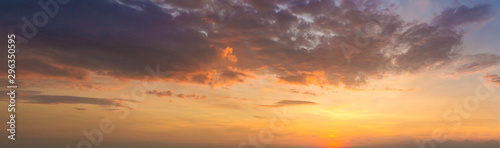 Panorama photo twilight sky background. Colorful Sunset sky and cloud.vivid sky in twilight time background. Fiery orange sunset sky. Beautiful - 296350595