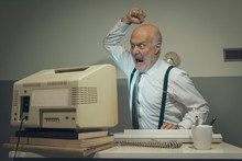 Angry Office Worker Hitting Hi...
