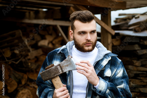 Fényképezés  Bearded lumberjack checkered clothes carry axe