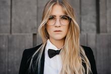 Portrait Of Blond Young Woman Wearing Black Tie And Blazer, Vienna, Austria