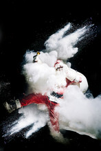 Santa Claus With Exploding Snow Bomb Against Black Background