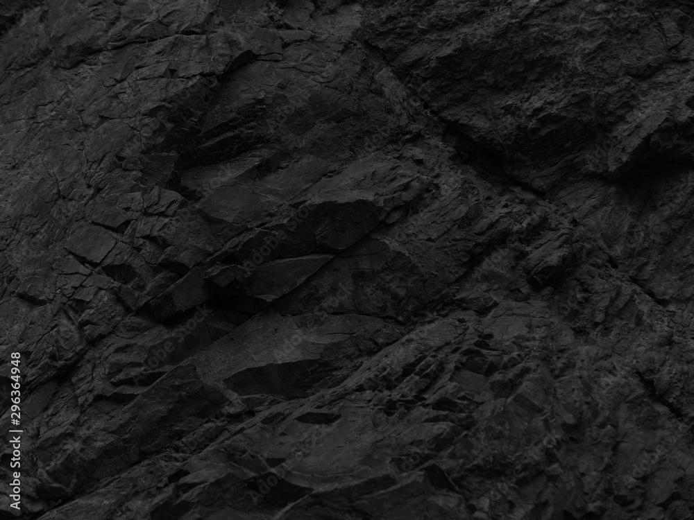 Fototapeta Black stone background. Mountain close-up. Fragment of the mountain. Black rock texture.