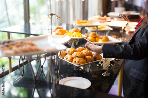 Fototapeta people group catering buffet food indoor, with food and beverage,Eat together