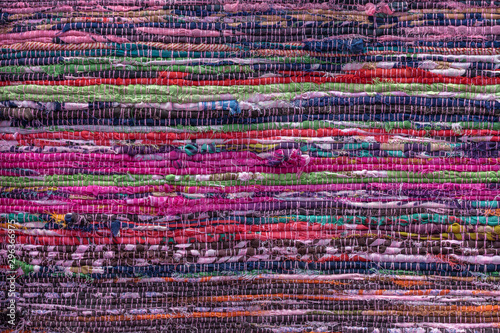 Obraz Cloth, typically produced by weaving or knitting textile fibers. Background and texture red old fabric. Closeup - fototapety do salonu