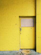 Old Yellow Building With Doors