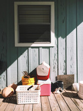 Direct View Of Household Items Kept On Patio On Sunny Day