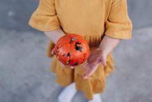 Pumpkin In The Hands Of A Girl