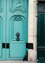 Ornately Carved Turquoise Door With Iron Door Knocker