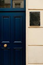 Dark Blue Door Next To White Wall