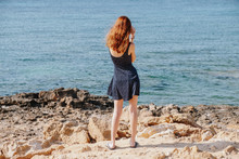 A Young Woman On Beach Relishing The Beauty Of Sea