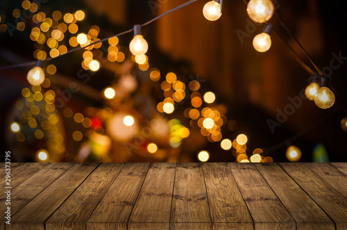 Image of wooden table in front of abstract blurred restaurant lights background - 296373795
