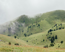 Clouds Over Landscape With Green Hills