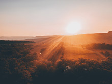 View Of Sun Rising Over Forest