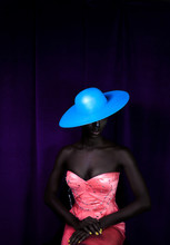 Model Wearing Blue Sun Hat And Bright Pink Formal Dress
