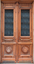 Old Wooden Door With Carved Ornaments.