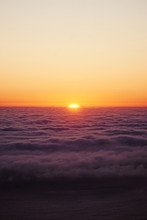 View Of Sunset Above Clouds