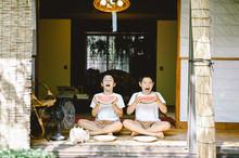 Portrait Of Siblings Eating Wa...