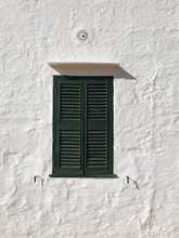 Front View Of Lime Wall And Green Wooden Window