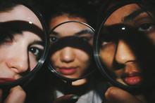 Three Faces Behind Magnifying ...