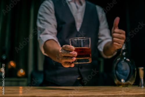 Foto auf Leinwand Alkohol man holding a glass of wine