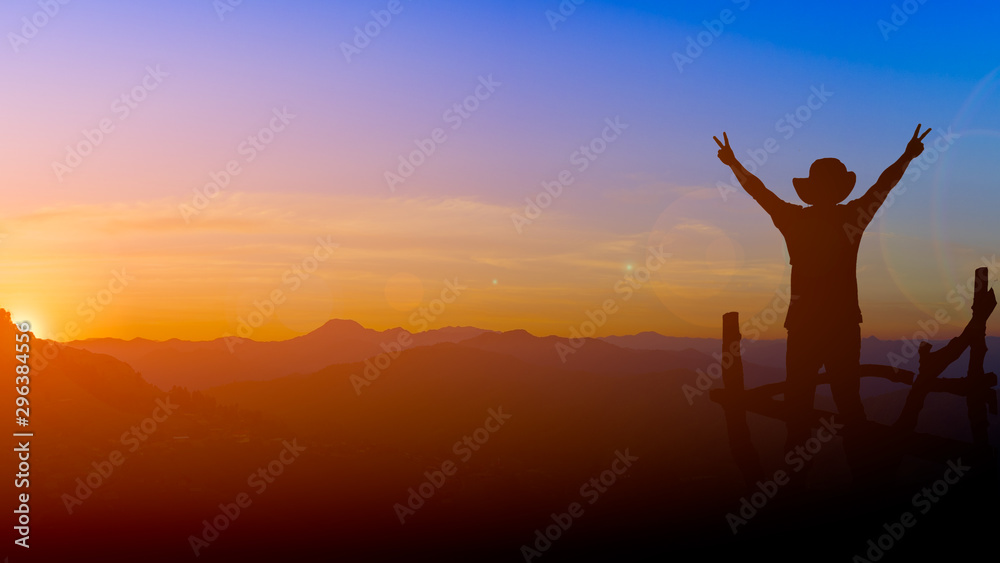 Fototapety, obrazy: silhouette picture backpacker man show two finger victory sign with lens flare sunset and mountain background twilight time copy space.