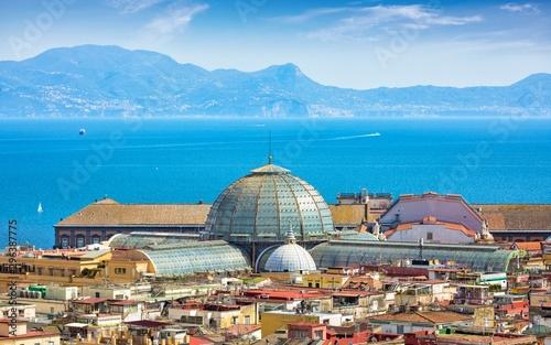 Montage in der Fensternische Südeuropa Domes of Galleria Umberto I towering over roofs of neighboring houses in Naples on background of Tyrrhenian Sea, Italy.