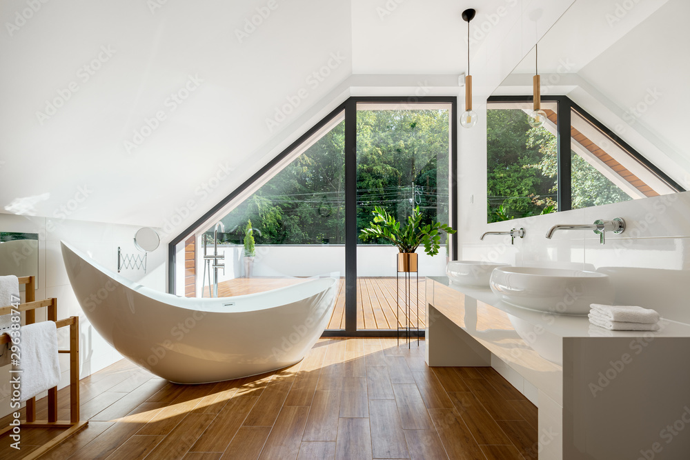 Fototapeta Elegant attic bathroom with bathtub